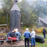 Volunteers get the Eclipse Lookout 100 HP boiler fired. This boiler powered all of the steam engines.