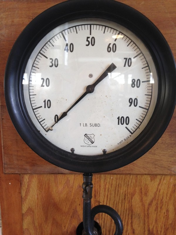 "Steam pressure gauge labeled ""Ashcroft"". Scale 0-100."