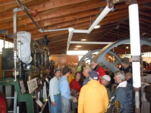 The crowd watches the Herreshoff triple-expansion steam engine.