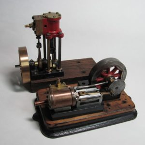 Photo 10. Restored vertical engine with the bronze flywheel and the horizontal engine.
