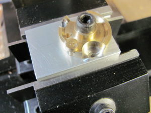 Photo 3. Partially machined crank disk mounted in the jig on the mill.