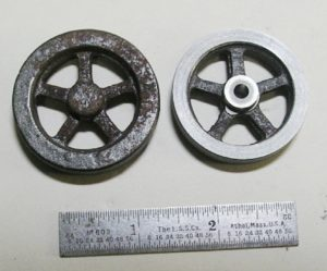 Photo 5. Rough and machined flywheels.